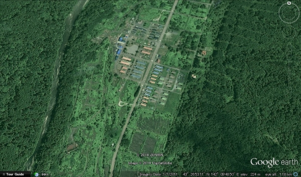 Decrepit and largely uninhabited block apartments, surrounded by abandoned blocks returning to scrubby grassland, and disused roads fading into the forest.  Raijo, southern Ashibetsu.