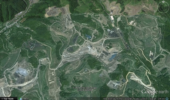 The vast, disused open pit mines of Utashinai.