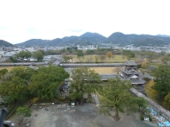 To the expansive, now empty west yards of the castle. The cityscape ends pretty quickly that way. Even the mountains here are different, more round and distinct than the long ridges of Kansai.